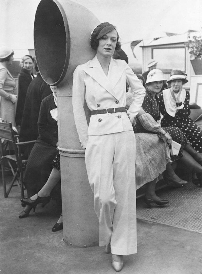 <p>Wait a minute...is that a pantsuit she's rocking? With the cinched belt detail, this is an impressively contemporary look for 1932. </p>