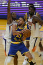Golden State Warriors guard Stephen Curry (30) shoots in front of Phoenix Suns forward Mikal Bridges, left, and center Deandre Ayton (22) during the second half of an NBA basketball game in San Francisco, Tuesday, May 11, 2021. (AP Photo/Jeff Chiu)