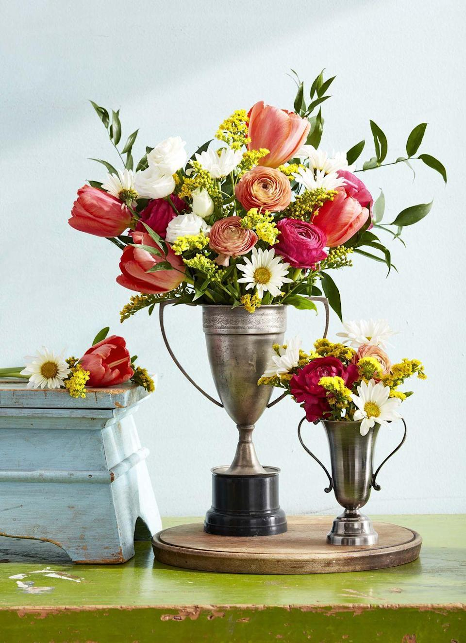 <p>Pull out your collection of vintage trophies and fill them with blooms cut from your yard.</p>