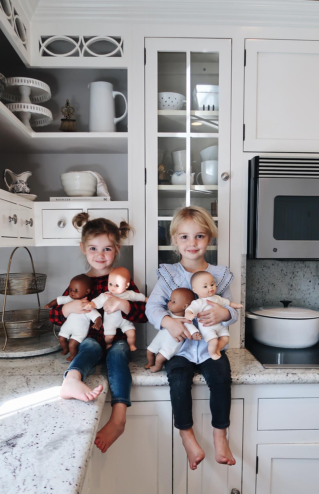 Mila and Emma holding their baby dolls. (Photo courtesy of K.C. Stauffer)