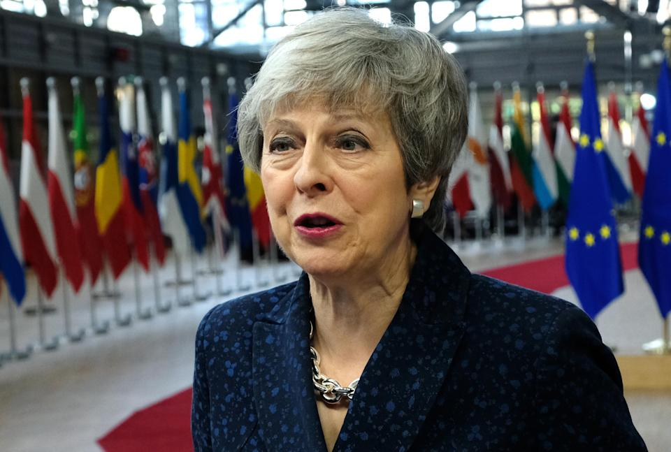 Theresa May speaks to the media as she arrives for a two-day summit of European Union leaders on March 21. (Getty)