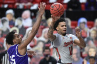 Texas Tech's Kyler Edwards (11) passes the ball during the first half of the team's NCAA college basketball game against TCU in Lubbock, Texas, Tuesday, March 2, 2021. (AP Photo/Justin Rex)