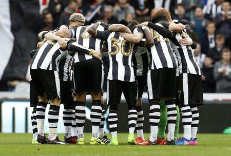 Newcastle United players huddle before the match