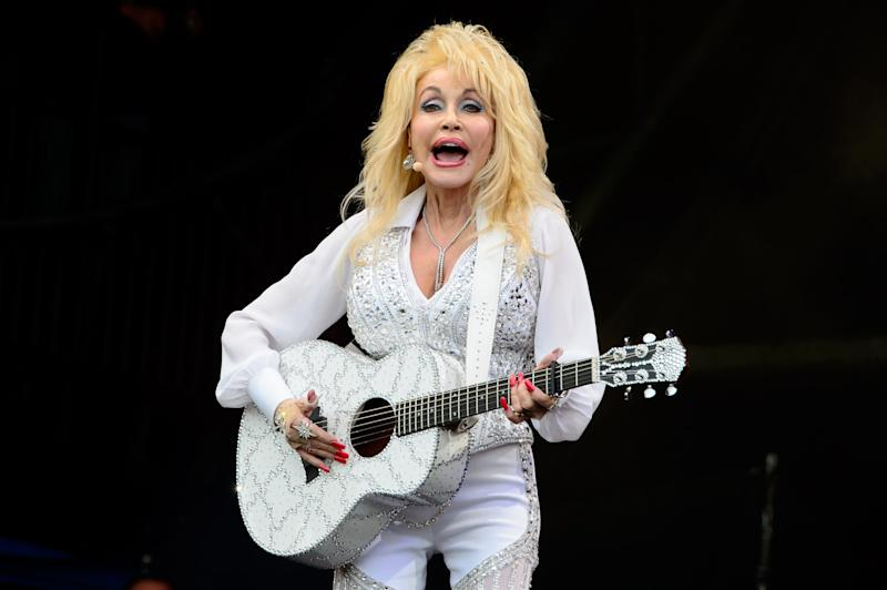 U.S singer Dolly Parton performs at Glastonbury music festival, England, Sunday, June 29, 2014. Thousands of music fans have arrived for the festival to see headliners Arcade Fire, Metallica and Kasabian. (Photo by Jonathan Short/Invision/AP)