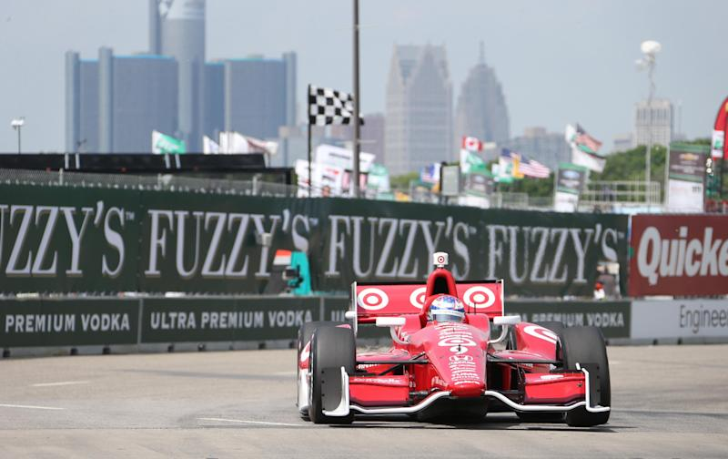 IndyCar driver Scott Dixon takes turn two during a practice session for the Detroit Grand Prix auto race on Belle Isle in Detroit, Friday, May 31, 2013. The Detroit Grand Prix will feature IndyCar's first attempt to have a pair of full-length auto races in the same weekend. (AP Photo/Carlos Osorio)