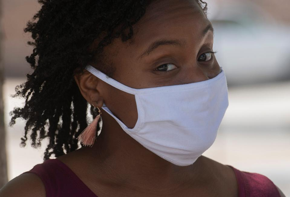 YMCA employee Fleuryne McGhe dons a cloth face mask to protect herself from the spread of coronavirus in Pensacola, Florida, on July 10, 2020.