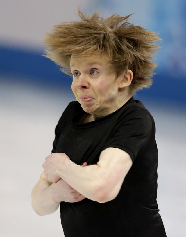 Kevin Reynolds of Canada competes in the men's short program figure skating competition at the Iceberg Skating Palace during the 2014 Winter Olympics, Thursday, Feb. 13, 2014, in Sochi, Russia. (AP Photo/Darron Cummings)