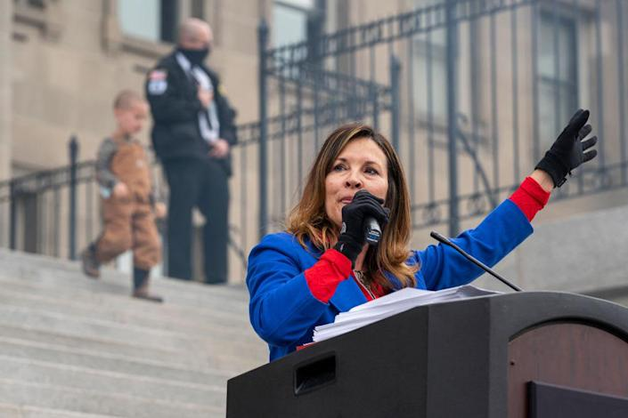 """<div class=""""inline-image__caption""""><p>Idaho Lt. Gov. Janice McGeachin speaks during a mask-burning event at the Idaho Statehouse on March 6, 2021.</p></div> <div class=""""inline-image__credit"""">Nathan Howard/Getty</div>"""