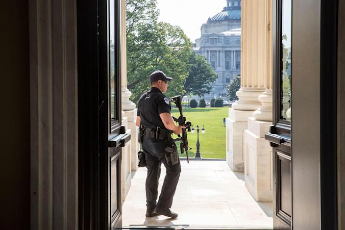 <p>A Capitol Hill Police officer stands his post at the entrance to the House of Representatives on Capitol Hill in Washington, Wednesday, June 14, 2017, after House Majority Whip Steve Scalise of La. was shot at a congressional baseball practice in Alexandria, Va. (Photo: J. Scott Applewhite/AP) </p>