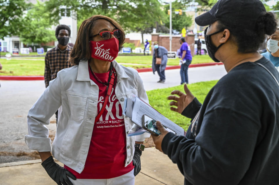 Mayoral candidate Sheila Dixon talks with new city voter Indria Tennessee at Edmondson Westside High School in Baltimore Tuesday, June 2, 2020. (Jerry Jackson/The Baltimore Sun via AP)