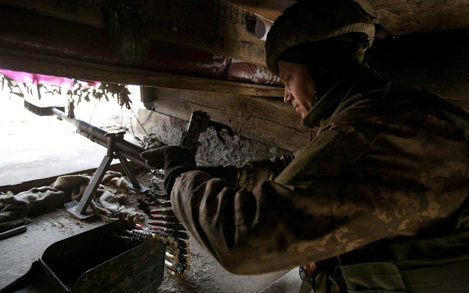 A Ukrainian serviceman on the front line in Donetsk region on February 19, 2021. - Anatolii Stepanov/AFP