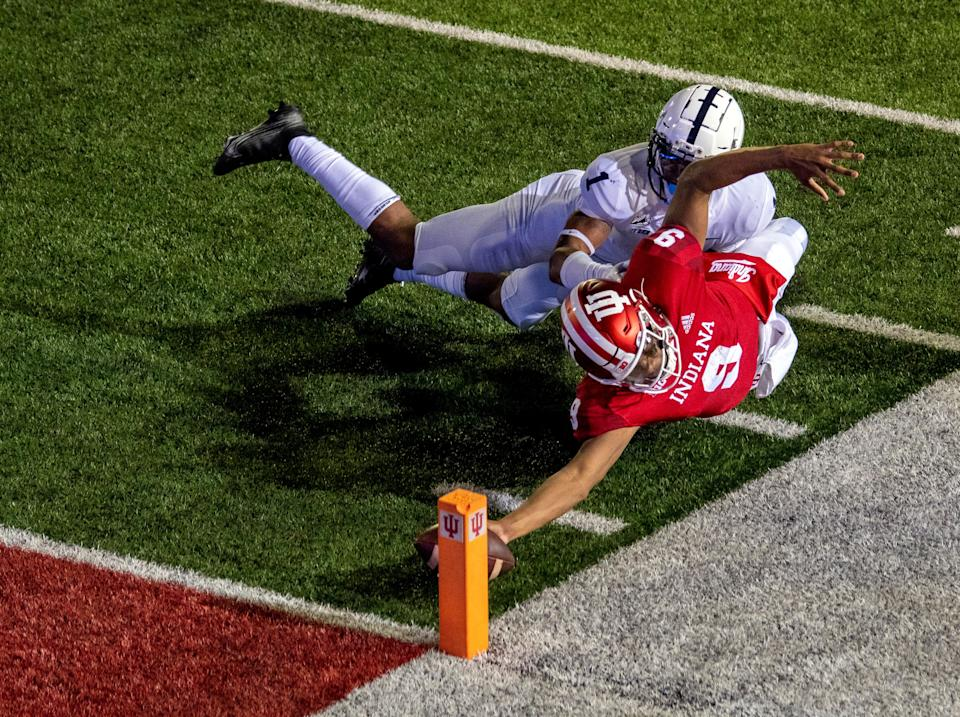 Oct 24, 2020; Bloomington, Indiana, USA;  Indiana Hoosiers quarterback Michael Penix Jr. (9) dives with the ball to score a two point conversion and win the game in overtime during the game at Memorial Stadium. The Indiana Hoosiers defeated the Penn State Nittany Lions 36 to 35.  Mandatory Credit: Marc Lebryk-USA TODAY Sports