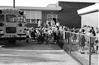 <p>Students pile off buses for their first day back to school after summer break.</p>
