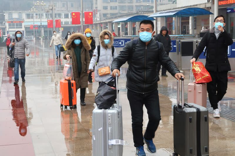 Passengers wearing masks are seen at the Changsha Railway Station, in Hunan