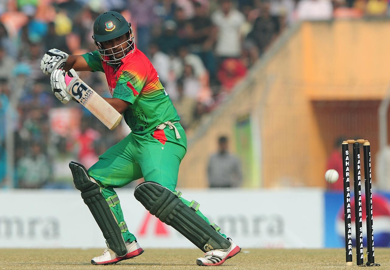 Bangladesh cricketer Tamim Iqbal plays a shot during the first one day international cricket match between Bangladesh and The West Indies at The Sheikh Abu Naser Stadium in Khulna on November 30, 2012. AFP PHOTO/ Munir uz ZAMAN
