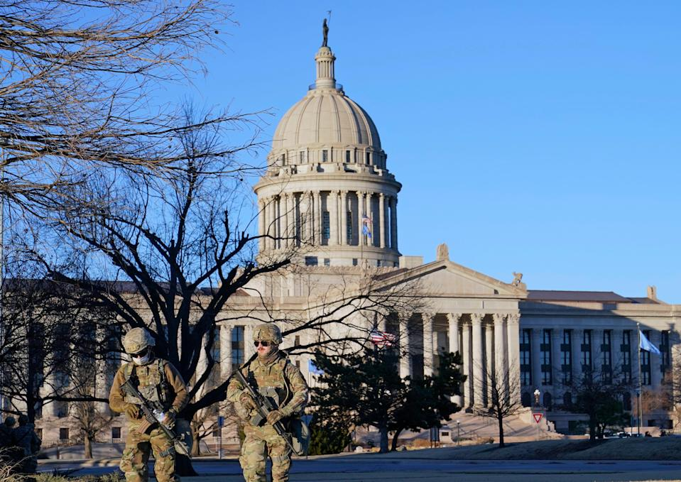 Oklahoma National Guard members patrol the mostly empty grounds near the Oklahoma Capitol on Sunday.