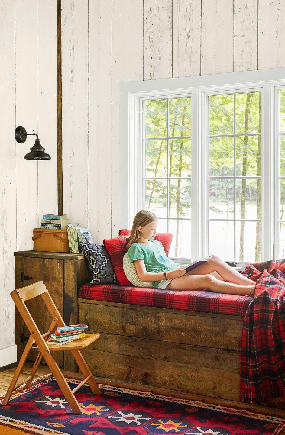 <p>A mix of wood tones, complemented by layers of tartan fabric, steal the show in this reading nook. </p>