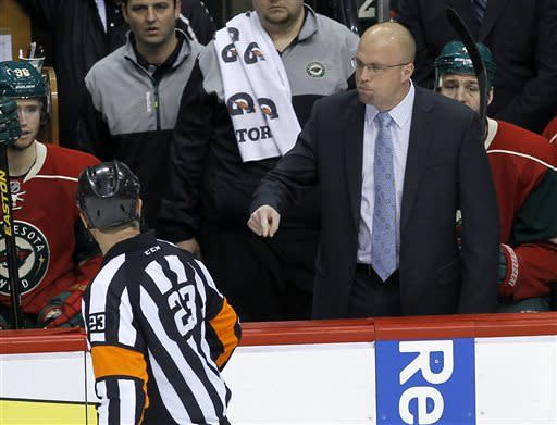Minnesota Wild head coach Mike Yeo argues with referee Brad Watson, left, after Wild right wing Charlie Coyle was charged with a match penalty after checking Columbus Blue Jackets center Brandon Dubinsky in the head, Saturday, April 13, 2013, during the first period of an NHL hockey game in St. Paul, Minn. (AP Photo/Ann Heisenfelt)