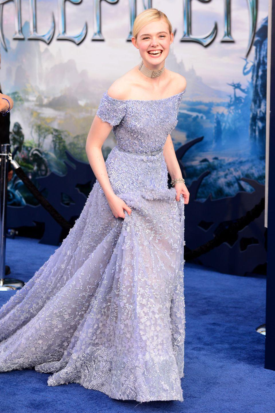 <p>While the costumes Elle Fanning wore as Aurora in 2014's <em>Maleficent</em> didn't have much in common with the gowns in the animated version, the actress gave a nod to the iconic blue dress by wearing an updated Elie Saab number at the movie's premiere.</p>