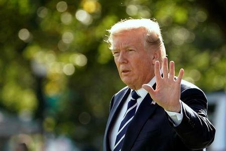 U.S. President Donald Trump waves as he walks on South Lawn of the White House before his departure to Greer, South Carolina, in Washington, U.S., October 16, 2017. REUTERS/Yuri Gripas