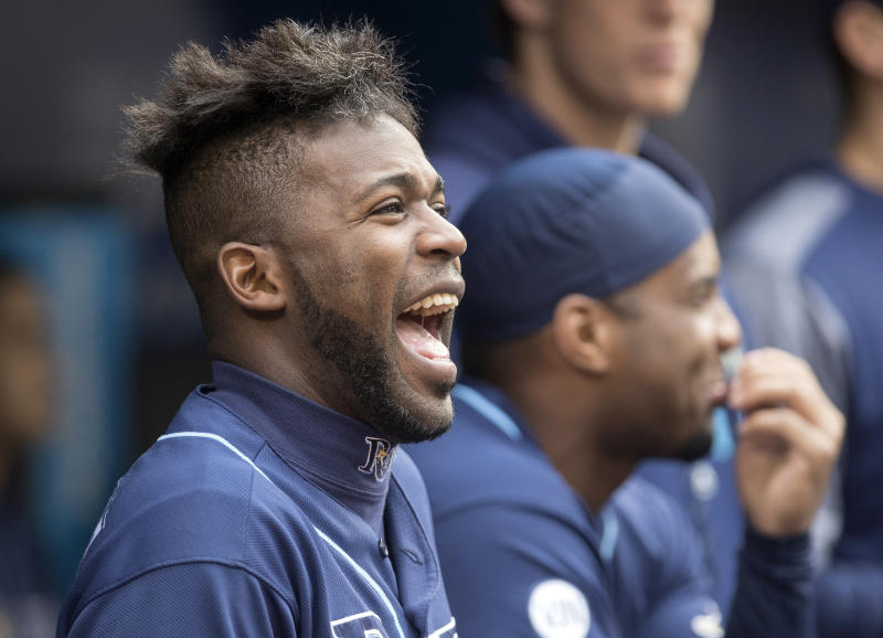 Tampa Bay Rays' Guillermo Heredia laughs in the dugout during a baseball game against the Toronto Blue Jays in Toronto, Sunday, Sept. 29, 2019. (Fred Thornhill/The Canadian Press via AP)