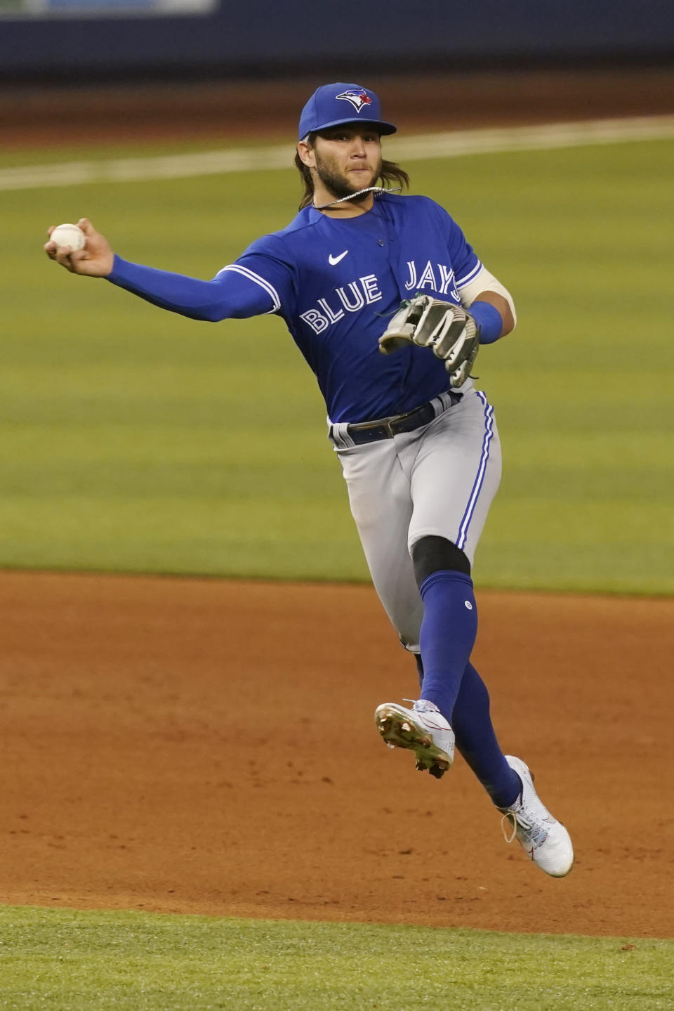 Toronto Blue Jays shortstop Bo Bichette (11) throws to first base on a hit by Miami Marlins' Starling Marte during the ninth inning of a baseball game, Tuesday, June 22, 2021, in Miami. The Blue Jays defeated the Marlins 2-1. (AP Photo/Marta Lavandier)