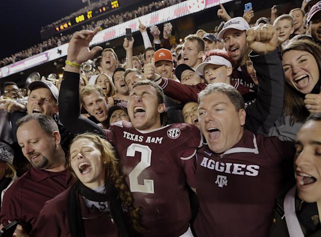 Texas A&M quarterback Johnny Manziel (2) celebrates with fans after an NCAA college football game against Mississippi State Saturday, Nov. 9, 2013, in College Station, Texas. Texas A&M won 51-41. (AP Photo/David J. Phillip)