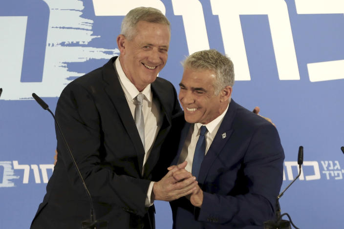 Retired Israeli military chief Benny Gantz, left, with Yair Lapid, head of the Yesh Atid party, as they launch<span> their new Blue and White alliance </span>for the upcoming Israeli elections, in Tel Aviv on Feb. 21. (Photo: Ariel Schalit/AP)
