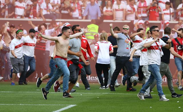 Football Soccer - VfB Stuttgart v Wurzburger Kickers - 2. Bundesliga - Mercedes-Benz Arena, Stuttgart, Germany - 21/5/17 VfB Stuttgart fans celebrate promotion on the pitch after the match Reuters / Kai Pfaffenbach Livepic DFL RULES TO LIMIT THE ONLINE USAGE DURING MATCH TIME TO 15 PICTURES PER GAME. IMAGE SEQUENCES TO SIMULATE VIDEO IS NOT ALLOWED AT ANY TIME. FOR FURTHER QUERIES PLEASE CONTACT DFL DIRECTLY AT + 49 69 650050.