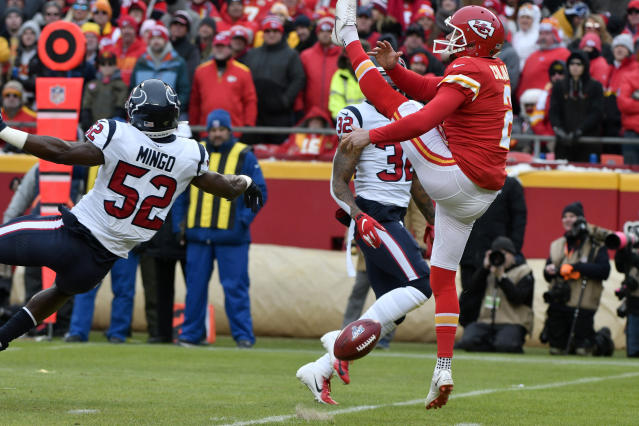 Houston Texans linebacker Barkevious Mingo (52) blocks a punt by Kansas City Chiefs punter Dustin Colquitt (2). (AP Photo/Ed Zurga)