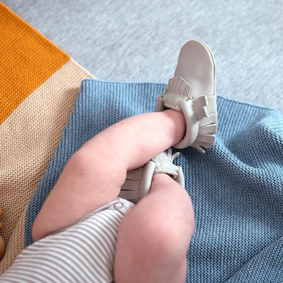 """Your kid will look so darn cute in these booties that'll actually stay on their feet.<br /><br /><strong>Promising review:</strong>""""Fit my 7-week-old baby girl perfectly and SO soft and cute! These are adorable and we love them as an alternative to socks, which slip right off little feet."""" —<a href=""""https://amzn.to/3tCNwA5"""" target=""""_blank"""" rel=""""nofollow noopener noreferrer"""" data-skimlinks-tracking=""""5189597"""" data-vars-affiliate=""""Amazon"""" data-vars-href=""""https://www.amazon.com/gp/customer-reviews/RJGUJ6LXPICKF?tag=bfheather-20&ascsubtag=5189597%2C8%2C44%2Cmobile_web%2C0%2C0%2C160757"""" data-vars-keywords=""""cleaning,fast fashion"""" data-vars-link-id=""""160757"""" data-vars-price="""""""" data-vars-product-id=""""15996794"""" data-vars-retailers=""""Amazon"""">oystersandpearls<br /><br /></a><strong><a href=""""https://amzn.to/3hlPqCX"""" target=""""_blank"""" rel=""""noopener noreferrer"""">Get them from Amazon for$39+(available in one-size and two styles).</a></strong>"""