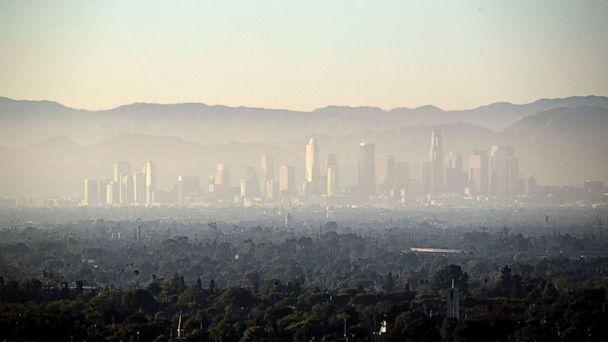 PHOTO: A layer of smog covers Downtown and the nearby areas in Los Angeles, August 14, 2019. (Etienne Laurent/EPA-EFE/REX via Shutterstock)