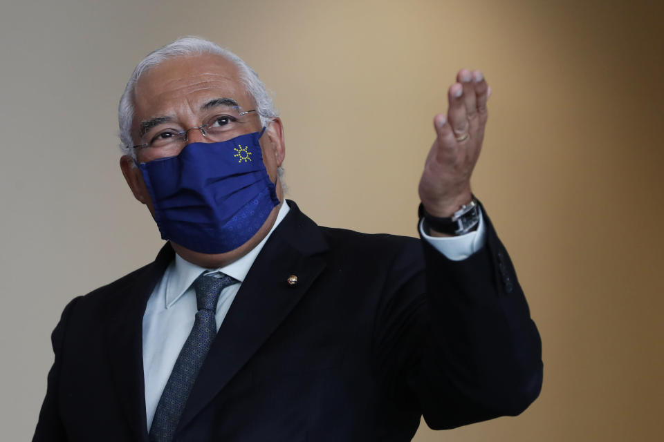 """Portuguese Prime Minister Antonio Costa gestures after a group photo with EU Commissioners in Lisbon, Friday, Jan. 15, 2021. The Portuguese government has considered """"without logic"""" the U.K.'s decision to ban travel from Portugal to ensure a new variant of COVID-19 found in Brazil doesn't derail the country's vaccination program. (AP Photo/Armando Franca)"""
