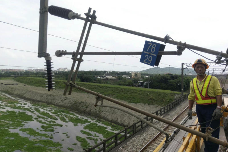 In this photo released by Taiwan Railways Administrations, a worker stands near damaged facilities for the railway line near Hualien in eastern Taiwan Thursday, April 18, 2019. A strong earthquake rattled eastern Taiwan early Thursday afternoon, causing scattered light damage in the capital and the eastern coast region. (Taiwan Railways Administrations via AP)