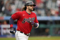 Cleveland Indians' Austin Hedges runs the bases after hitting a solo home run in the third inning in the first baseball game of a doubleheader against the Chicago White Sox, Thursday, Sept. 23, 2021, in Cleveland. (AP Photo/Tony Dejak)
