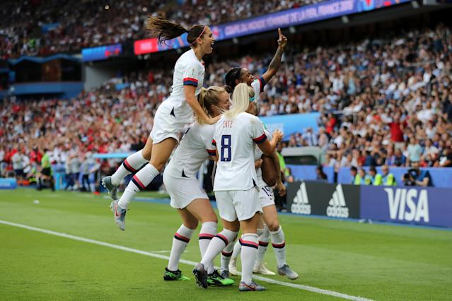 Megan Rapinoe of the USA celebrates with teammates after scoring her team's first goal during the 2019 FIFA Women's World Cup France Quarter Final match between France and USA at Parc des Princes on June 28, 2019 in Paris, France. (Photo by Elsa/Getty Images)