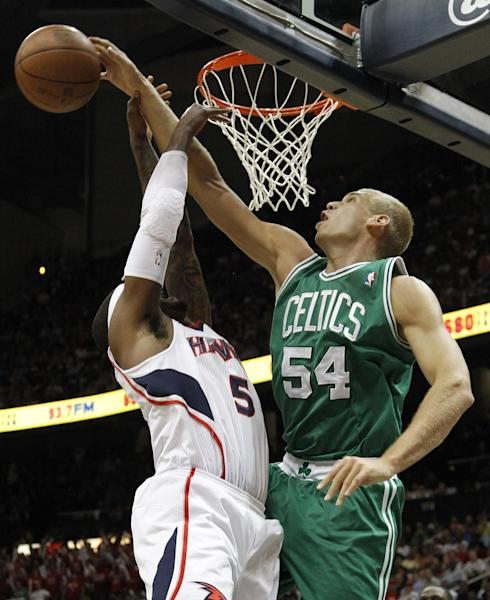 Atlanta Hawks Josh Smith has his shot blocked by Boston Celtics center Greg Stiemsma (54) during the first half of Game 5 of an NBA first-round playoff series basketball game Tuesday, May 8, 2012, in Atlanta. (AP Photo/John Bazemore)