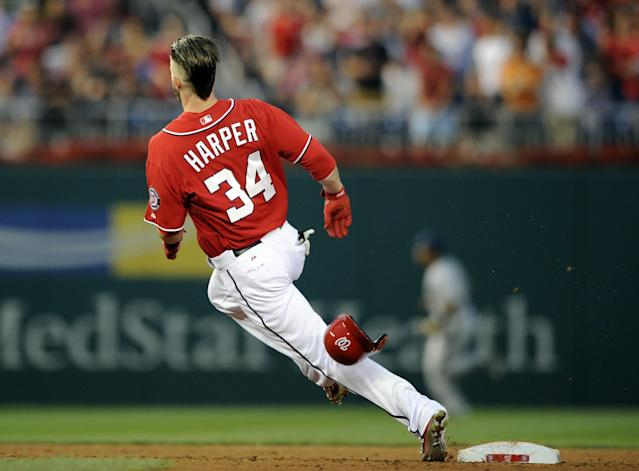 Washington Nationals' Bryce Harper rounds second on a double against the Milwaukee Brewers during the third inning of a baseball game, Saturday, July 19, 2014, in Washington. (AP Photo/Nick Wass)
