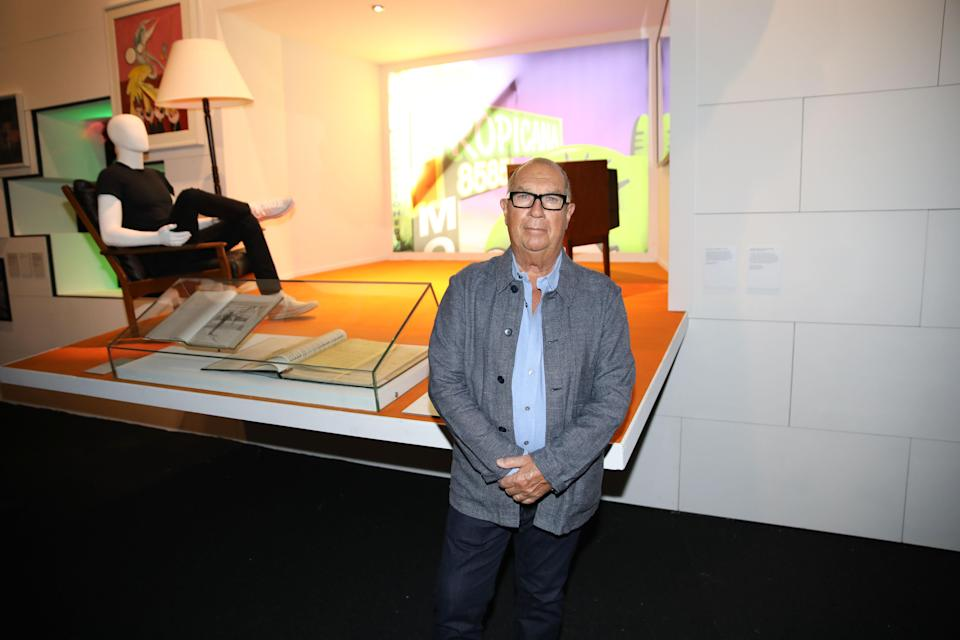 """Aubrey Powell, Hipgnosis co-founder and co-curator of """"The Pink Floyd Exhibition: Their Mortal Remains,"""" in front of a set for a """"The Wall"""" tour - Credit: Alex Kluft"""