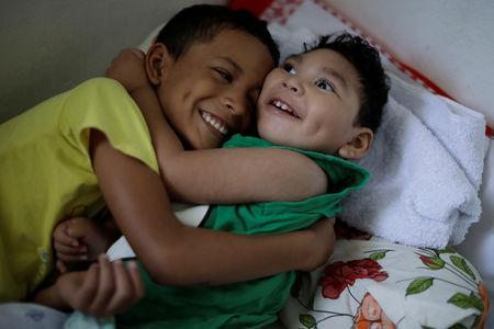 Daniel Vieira, who is two years old, and was born with microcephaly, is greeted by his brother at their house in Olinda, Brazil, August 7, 2018. REUTERS/Ueslei Marcelino/Files