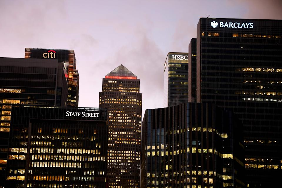 """The offices of banking giants Citi, HSBC and Barclays are pictured at the the secondary central business district of Canary Wharf on the Isle of Dogs, east London on December 11, 2020. - A Brexit trade deal between Britain and the European Union looked to be hanging in the balance on Friday, after leaders on both sides of the Channel gave a gloomy assessment of progress in last-gasp talks. The Bank of England said Friday that UK banks remained """"resilient"""" to the risks of Brexit and coronavirus, but warned financial services could face """"disruption"""" when the transition period ends. (Photo by Tolga Akmen / AFP) (Photo by TOLGA AKMEN/AFP via Getty Images)"""