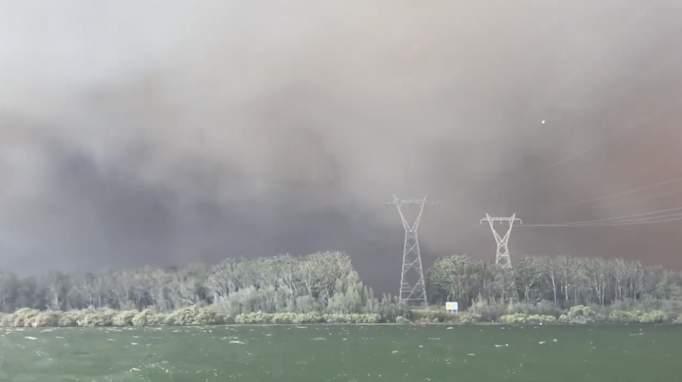 The smoke was so thick it was hard to see the flames as the surrounding hills burned. Source: Supplied