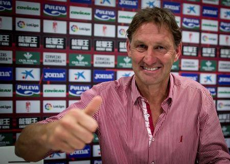 Former Arsenal and England captain Adams smiles after being presented as new head coach of Granada soccer club in Granada