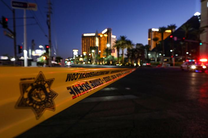 Police block the roads leading to the Mandalay Hotel (background) and inspect the site after a gunman attack in Las Vegas, NV, on Oct. 2, 2017. At least 59 people were killed and more than 527 others wounded at a country music concert in the city of Las Vegas late Sunday night in the mass shooting. (Photo: Bilgin S. Sasmaz/Anadolu Agency/Getty Images)