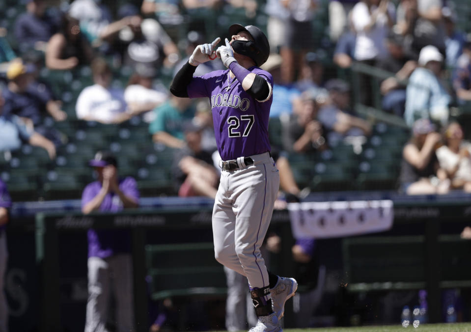 Colorado Rockies' Trevor Story points up after hitting a solo home run on a pitch from Seattle Mariners starting pitcher Justus Sheffield during the fourth inning a baseball game, Wednesday, June 23, 2021, in Seattle. (AP Photo/John Froschauer)