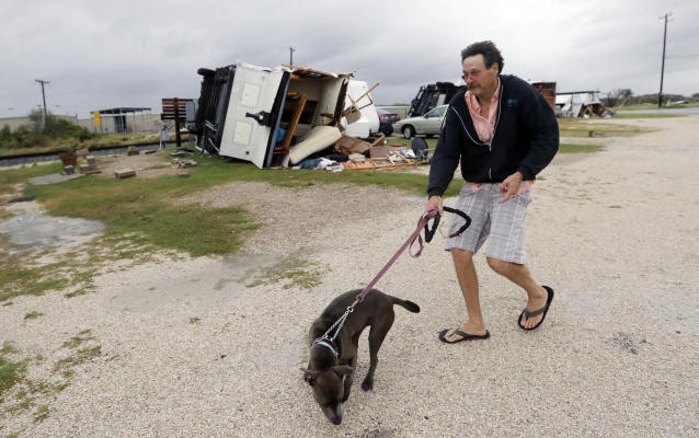 J.G. Roberson walks his dog, Peace, past a trailer overturned by the winds of Hurricane Harvey, Saturday, Aug. 26, 2017, in Aransas Pass, Texas. Roberson rode the storm out in his own trailer. (Photo: Eric Gay/AP)