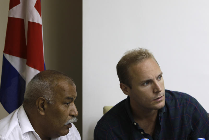 Swedish citizen Jens Aron Modig listens to a translator during a press conference in Havana, Cuba, Monday, July 30, 2012. Modig and Spanish citizen Angel  Carromero who were traveling with Cuban dissident Oswaldo Paya when he died in a car crash are denying speculation that a second vehicle was involved. Modig backs up investigators' report that the driver braked abruptly after entering an unpaved construction zone and lost control.  (AP Photo/Franklin Reyes)