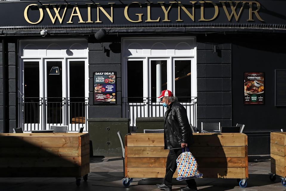 <p>Wales' pubs must stop serving alcohol after 6pm until at least December 17</p> (AFP via Getty Images)