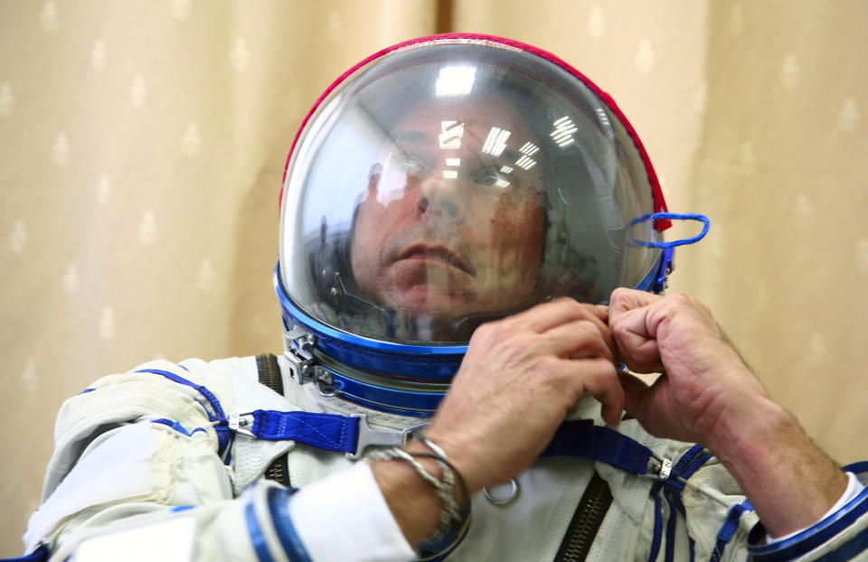 Guy Laliberte prepares for exercises during a training session in the International Space Station (ISS) training module at the Star City space centre outside Moscow, August 25, 2009. The Canadian billionaire, also owner of Cirque du Soleil, is on the countdown to become the world's seventh, and Canada's first space tourist slated to travel on a Russian Soyuz space craft to the ISS in September.  REUTERS/Sergei Remezov  (RUSSIA SCI TECH TRANSPORT SOCIETY IMAGES OF THE DAY)