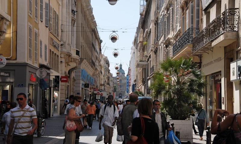 People promenade the Rue St. Ferreol boulevard in downtown Marseille